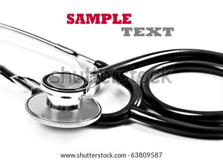 Close up of a doctor's stethoscope in black on a white background with space for text - stock photo