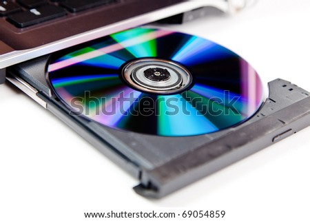 close up of a dvd in a laptop tray