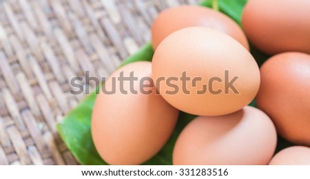 close up of a egg on a banana leaf - stock photo