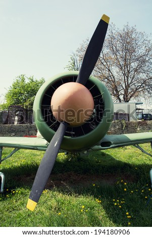 Close up of a engine propeller aircraft. Single-engine aircraft. Retro style. - stock photo