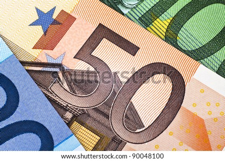 Close up of a 50 euro note between other euro banknotes - stock photo