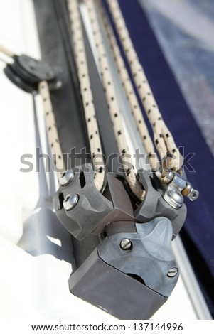 Close-up of a fasten rope. Yacht details - stock photo
