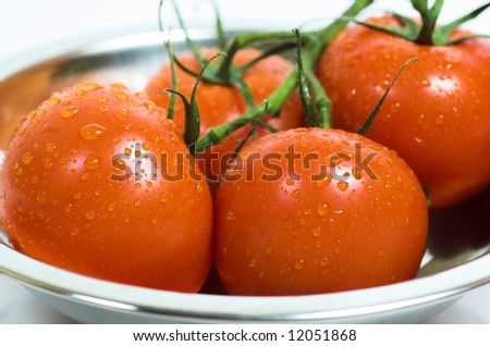 Close-up of a few fresh tomatoes in a bowl