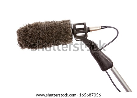 Close-up of a fluffy windshield on a boom microphone against a white background