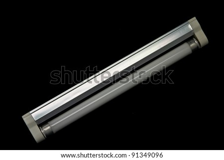 close up of a fluorescent tube on a black background - stock photo