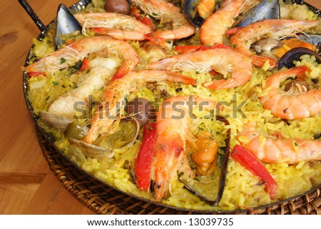 Close up of a fresh made paella from Valencia - stock photo