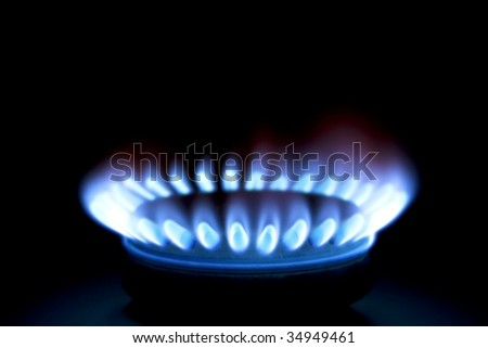 Close up of a gas burner isolated on black background - stock photo