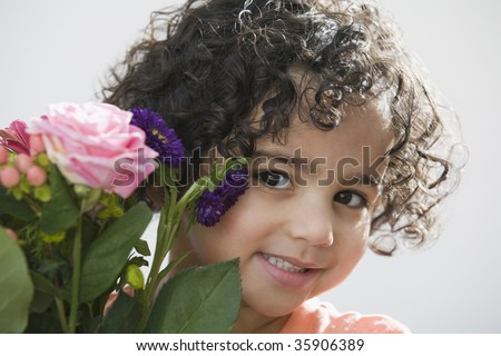 Close-up of a girl holding a bouquet of flowers - stock photo