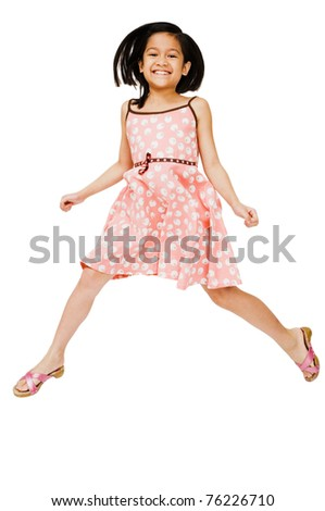 Close-up of a girl jumping and smiling isolated over white - stock photo