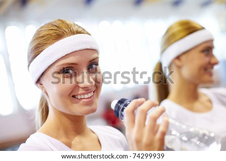 Close-up of a girl?s face drinking water - stock photo