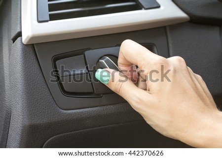 close-up of a girl's hand on the dashboard in a car