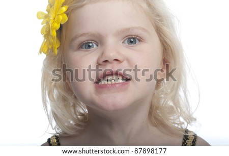 close up of a girl showing her teeth
