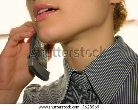 Close up of a girl speaking by phone.