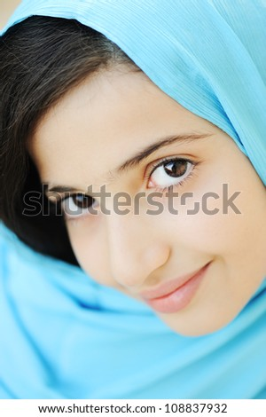 Close-up of a girl with hijab - stock photo