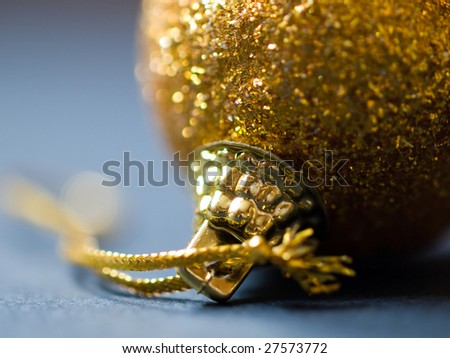 Close-up of a gold christmas ball.