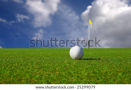 Close Up of a Golf Ball Lying on a Green. - stock photo