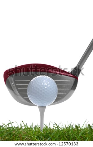 close up of a golf ball on the tee with a driver behind it,studio shot using real grass. - stock photo