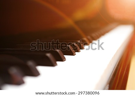 Close-up of a grand piano keyboard, very shallow DOF! - stock photo