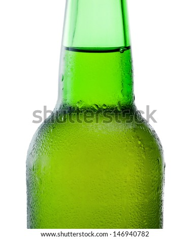 Close-up of a green beer bottle with condensation on white background - stock photo