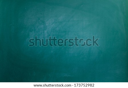 Close up of a Green dirty chalkboard - stock photo