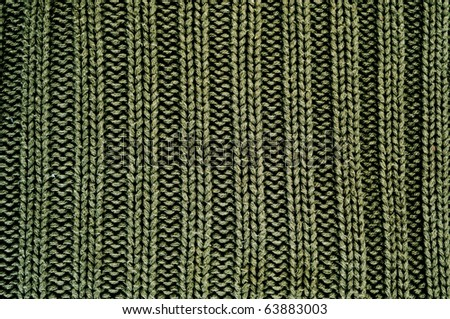 close up of a green knitted fabric - stock photo