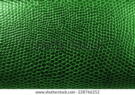close up of a green leather background