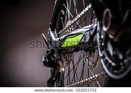 close-up of a green mountain bike, studio shot. - stock photo