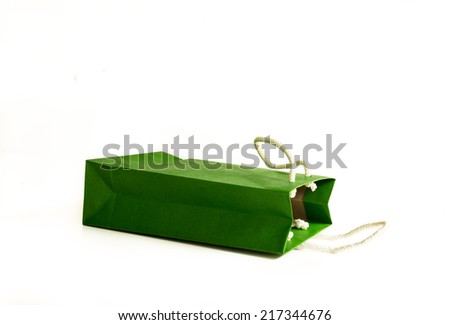 close up of a green paper bag on white background
