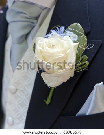 Close up of a groom's buttonhole - stock photo
