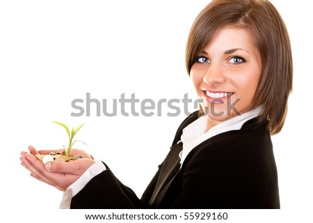 close-up of a growing plant with coins in womanâ??s hand