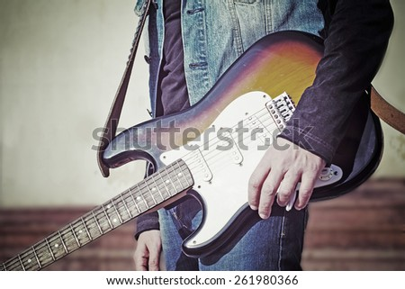 close up of a guitar player in vintage tone effect - stock photo