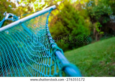 Close up of a hammock in a pastoral location. Narrow focus. - stock photo