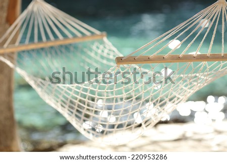 Close up of a hammock on a tropical beach resort vacation concept - stock photo