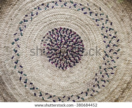 Close up of a hand-crafted matt made with palm leaf. - stock photo