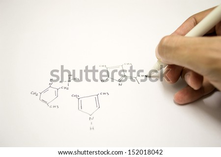 Close up of a hand drawing molecular structure scheme - stock photo