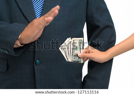 Close up of a hand giving a bribe - stock photo