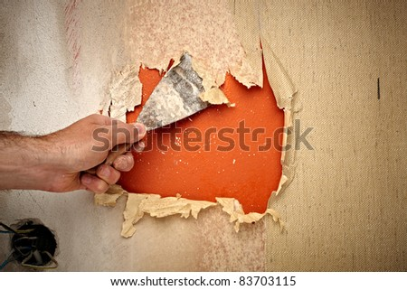 close up of a hand holding a spatula for renovation - stock photo