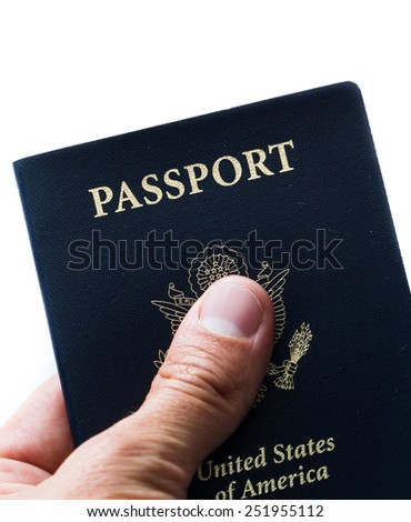 close up of a hand holding an american passport over a white background - stock photo