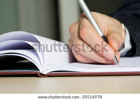 Close up of a hand of the writing businessman - stock photo