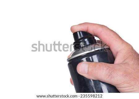 Close up of a hand on a aerosol spray bottle or canister  - stock photo