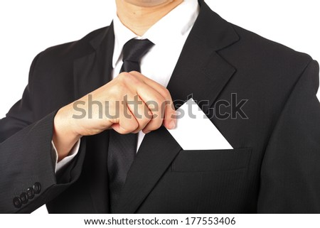 Close up of a hand taking out a business card - stock photo