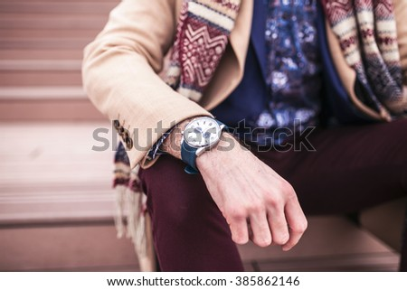 Close up of a hand with a wristwatch