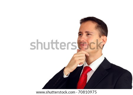 Close-up of a handsome young man in a suit looking up smiling - stock photo