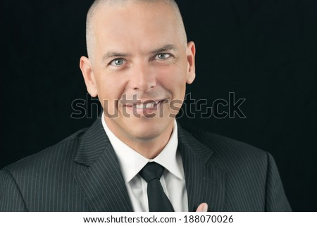 Close-up of a happy bald man smiling to camera. - stock photo
