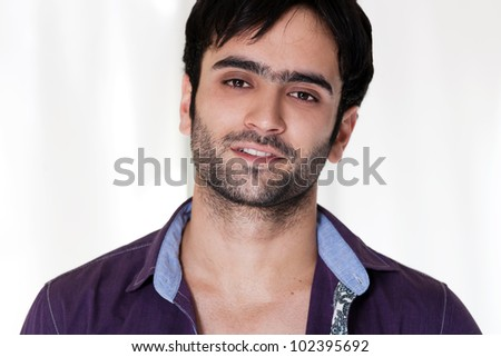 close up of a happy man wearing collared shirt
