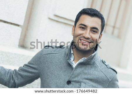 Close-up of a happy smile man wearing coat, coldly morning. Autmn day - stock photo