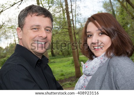 Close up of a happy young couple outside - stock photo