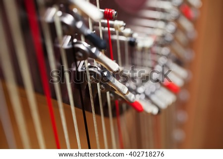 Close up of a harp with a shallow DOF. - stock photo