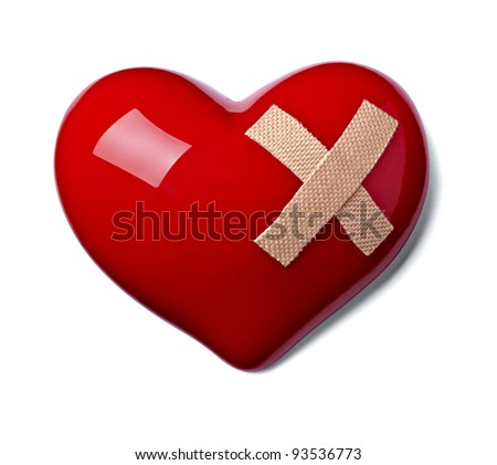 close up of a heart shape with bandage on white background - stock photo