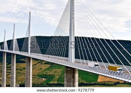 Close up of a highway bridge traffic (Millau Viaduct - France, highest bridge in the world) - stock photo